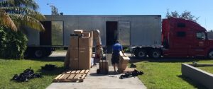 cardboard boxes in front of the truck awaiting for long distance movers Florida
