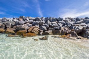 Clear sea-water and rocks, a frequent site when you move to Miami