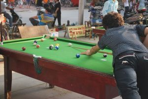 A women playing pool