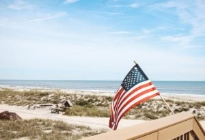 an American flag on a beach