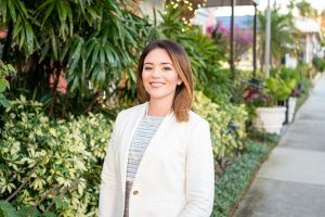 Real estate agent with a lush background