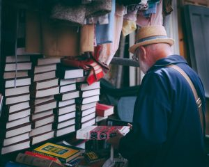 A man inspecting books