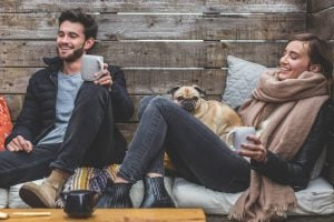 prepare your pet for a long distance move- a man, a woman and a dog