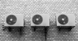 Three air conditioners on the wall