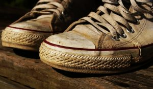 A pair of dirty old sneakers.
