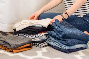 Packing guide for seniors- a woman packing clothes