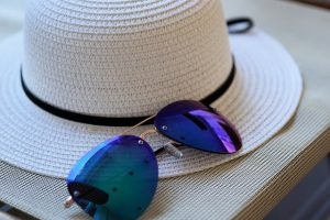 A sun hat and a pair of sunglasses.