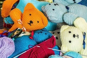 Stuffed teddy bears of different colors.