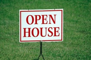 A sign that says 'open house'.