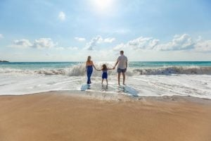 investing in a beach rental- a family on the beach