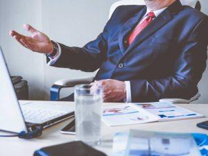 a man sitting behind a desk