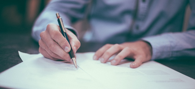 a man signing a document- pick the right insurance
