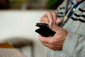 Old man using phone