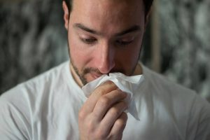protect yourself from coronavirus when moving to Miami- a sick man