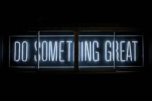 neon sign saying: do something great
