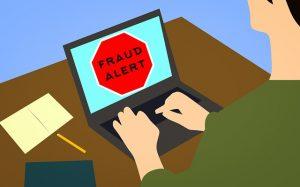 Fraud alert on computer screen