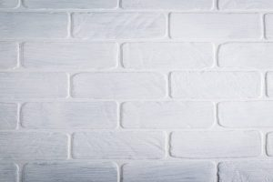 home improvement projects to take on during self-isolation: empty white brick wall