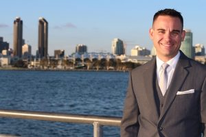 A real estate agent smiling