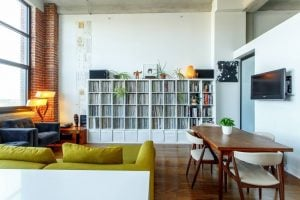 install big shelves as one of thespace saving ideas for your Miami apartment