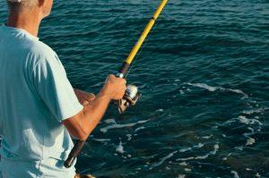 Man fishing on annual Fishing Rodeo.
