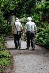 two seniors walking as a part of the best Senior activities in Coral Springs