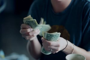 A person counting money