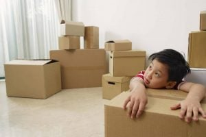 Boy with a pile of boxes