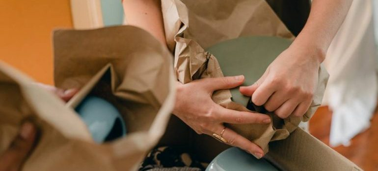 wrapping items in packing paper
