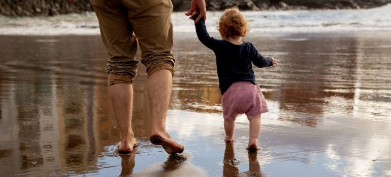 walking on the beach with your family