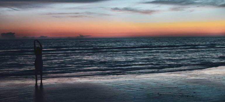 woman on a beach on sunset