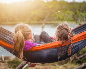 two girls in a hammoc