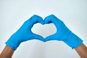 Blue gloves forming a heart shape