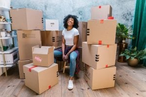 Picture of a woman surrounded with moving boxes