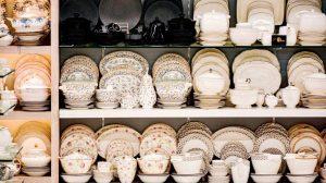 white ceramic bowls on a shelf
