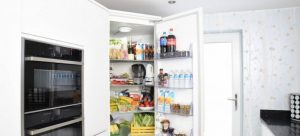 Open fridge with food and drinks in it