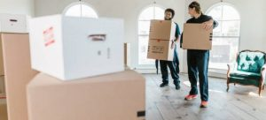 Men carrying boxes.
