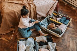A girl packing a suitcase