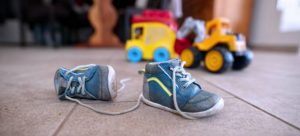 toys and shoes on the floor